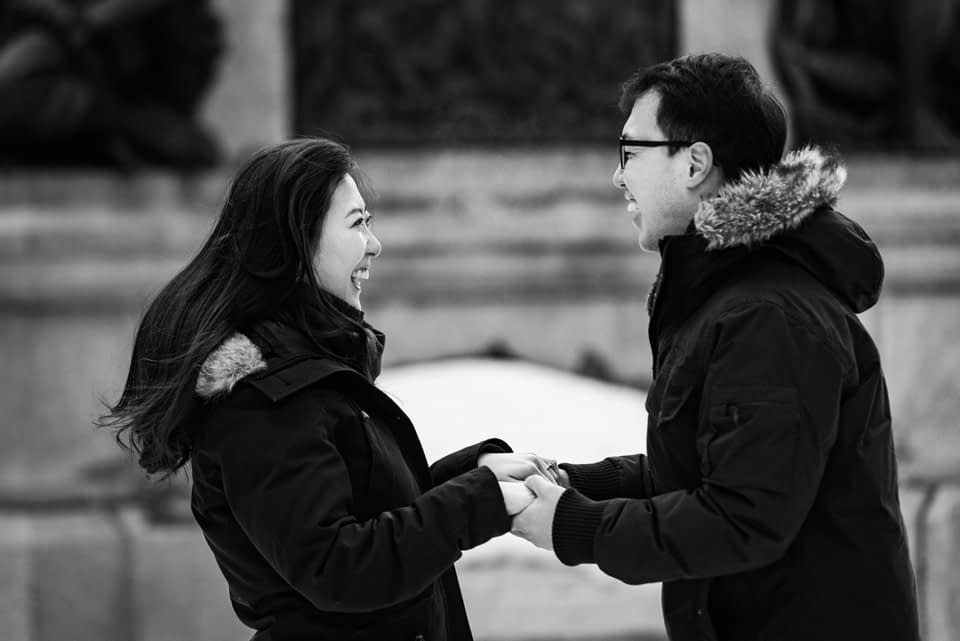 Black and white photo of reaction to surprise proposal