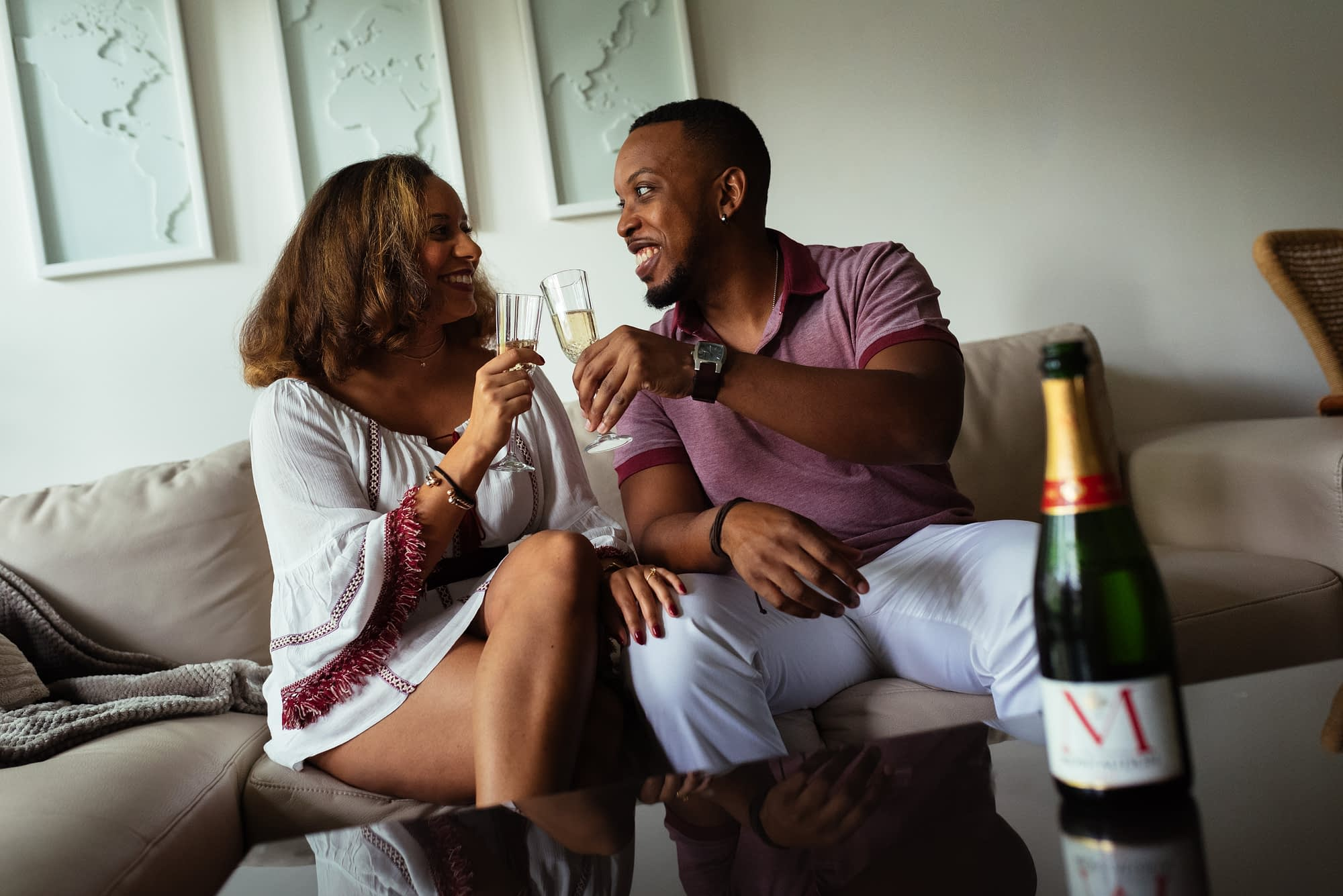 Engagement photos at home with champagne