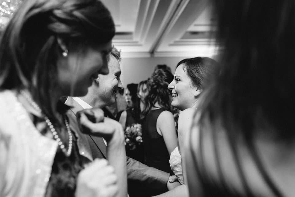 Newlyweds dancing with friends