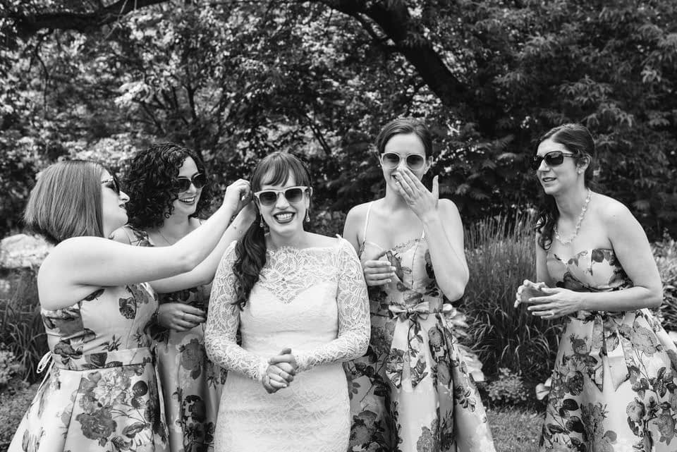 Bride getting ready for photo with friends