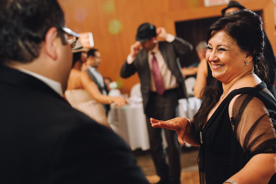 Woman smiling at groom