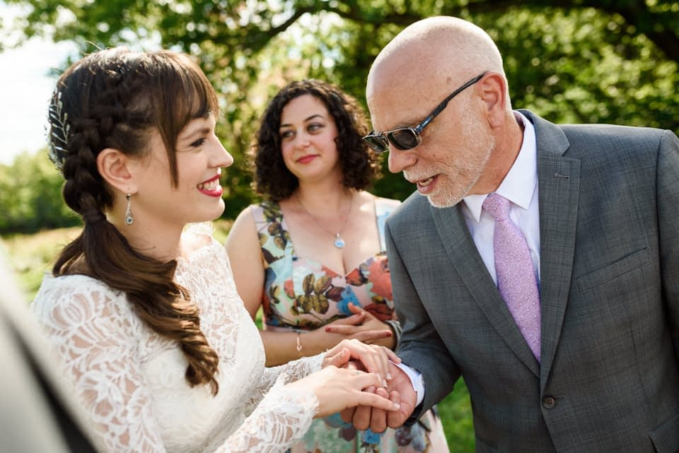 Bride's father admiring her wedding ring