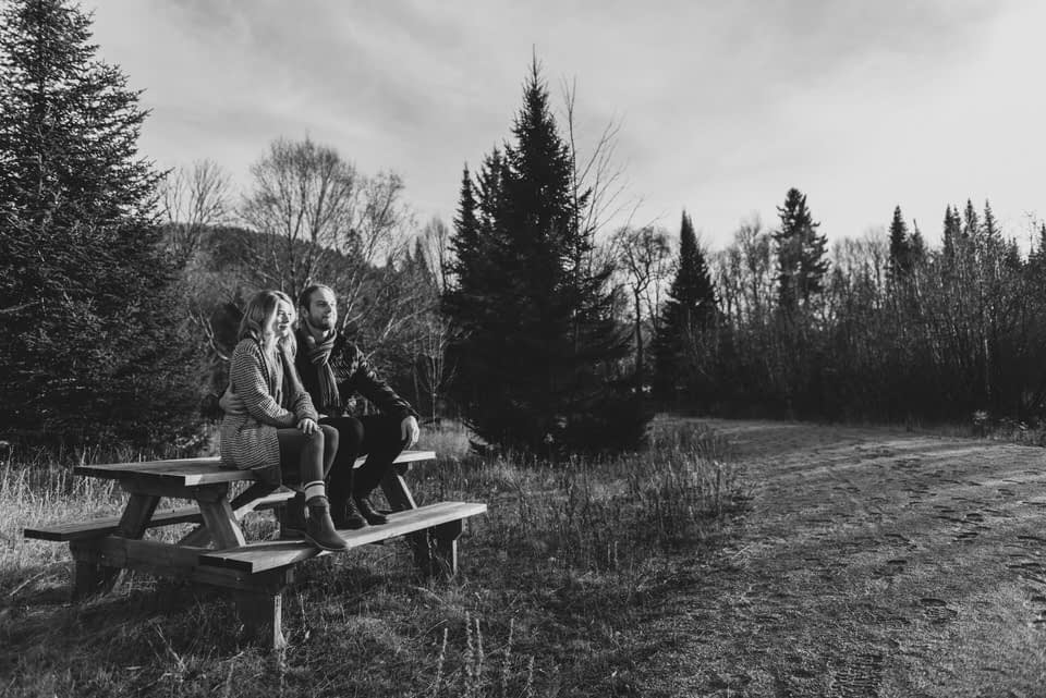 Black and white photo of couple on picnic bench at Mont-Tremblant