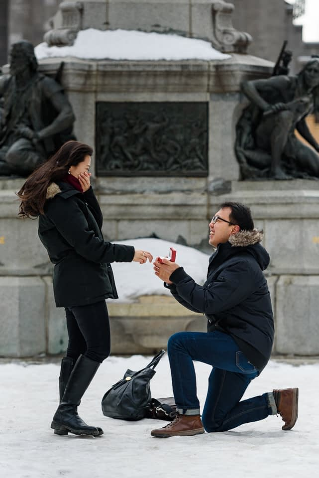 Surprise proposal in Place d'Armes Montreal