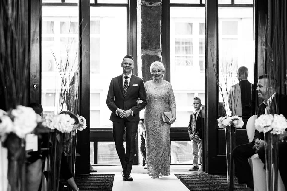 Groom and mother entering Hotel Nelligan wedding ceremony