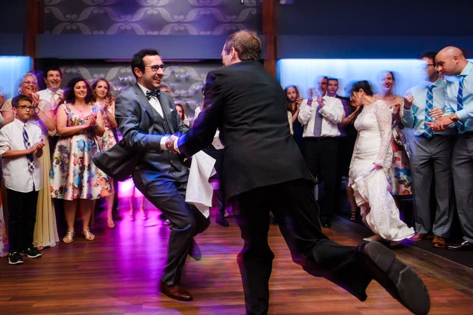 Groom spinning with his father during the hora