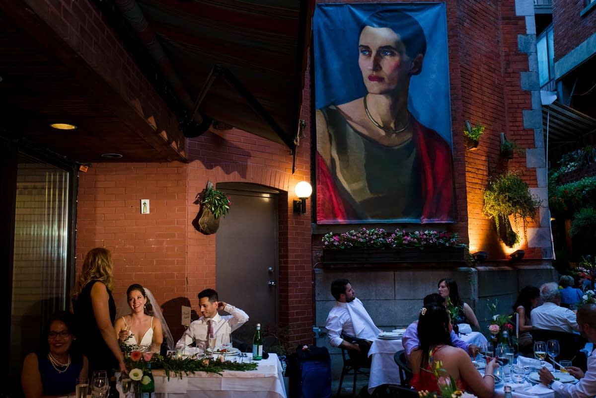 Wedding couple having dinner at Il Cortile restaurant during their wedding during the pandemic