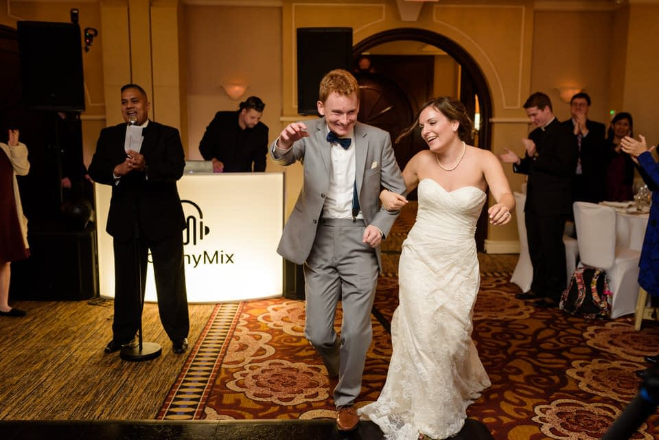 Married couple entering wedding reception at Loews Hotel Vogue