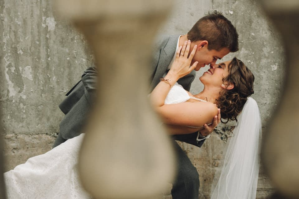 Groom dipping the bride for a kiss at Espace Canal wedding in Montreal