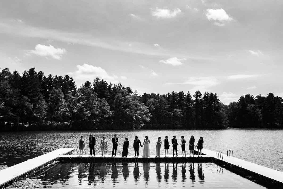 Wedding party portrait on a dock at a lake