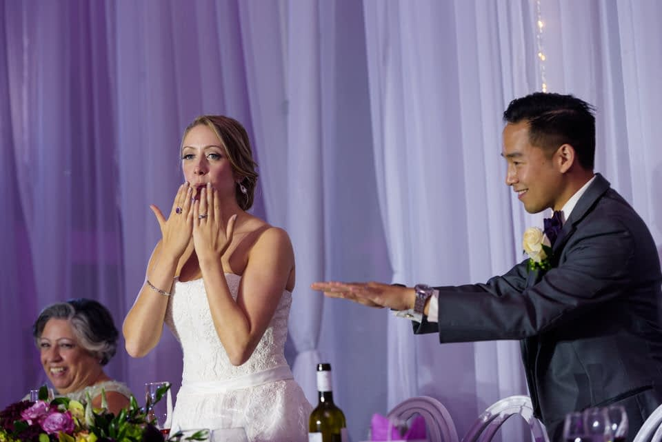 Bride and groom thanking their wedding guests
