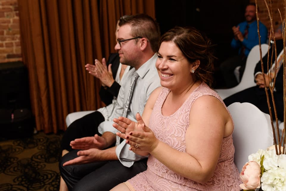 Guests clapping at Hotel Nelligan ceremony