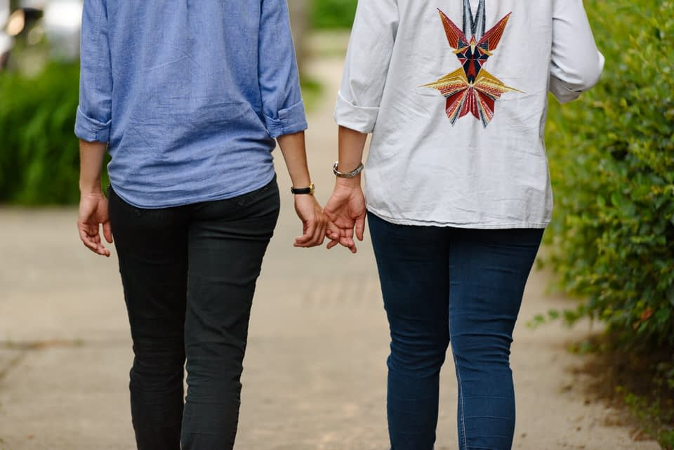 Lesbian couple holding hands and strolling