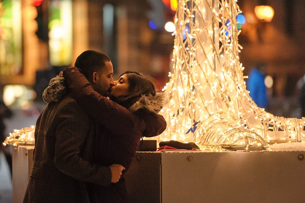 Couple kissing after proposal in Old Montreal