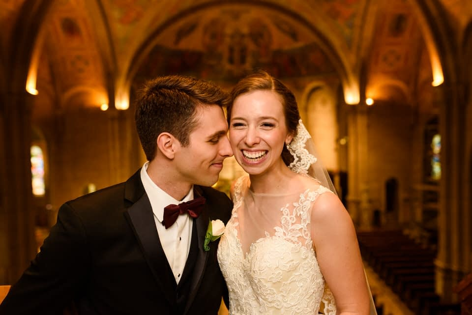 Wedding couple kissing in church after ceremony