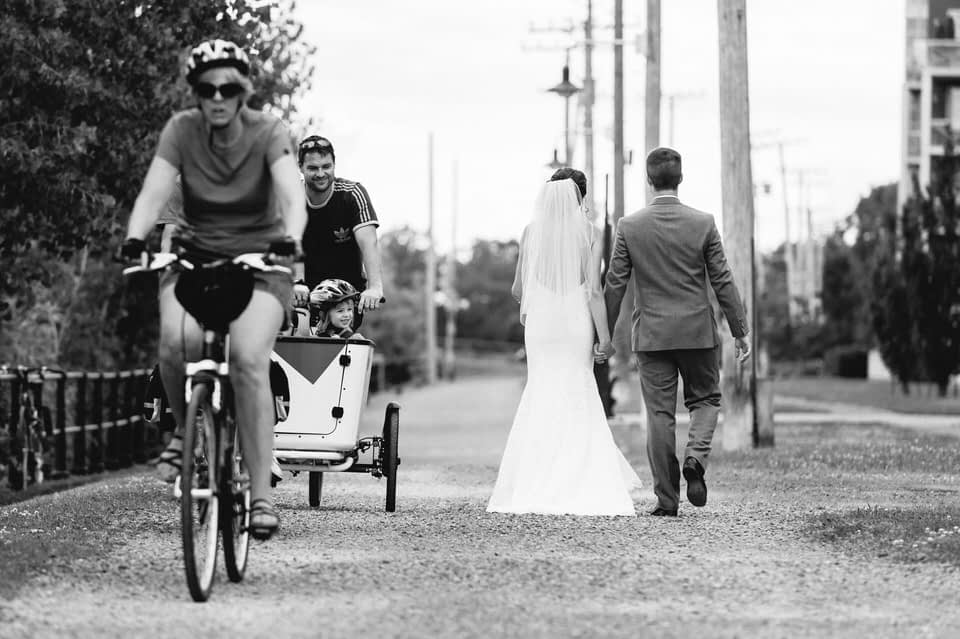 Wedding couple holding hands and walking along Lachine Canal