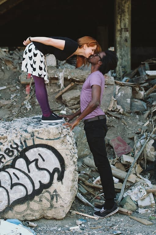 Graffiti engagement photos in an abandoned building