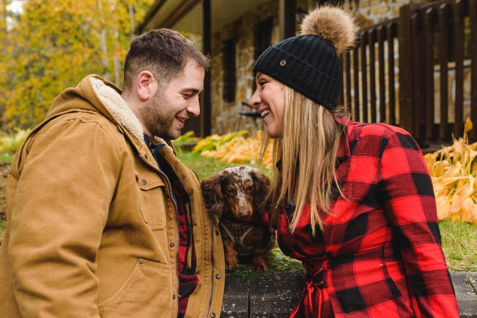 Fall engagement photo with their dog