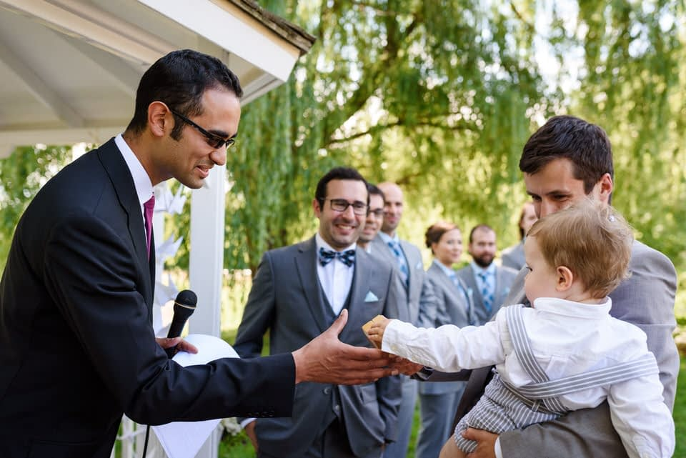 Officiant greeting the ring bearer