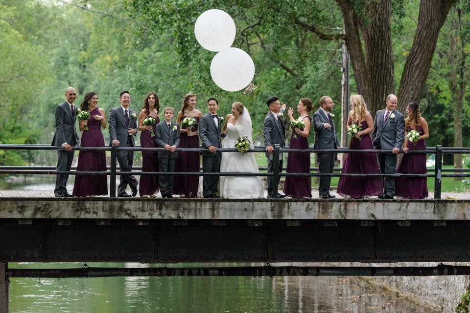 Wedding party with balloons on a bridge crossing the Lachine Canal