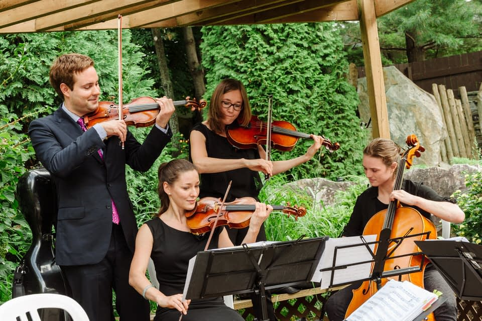 Ensemble Tryade musicians playing at outdoors wedding at Parc Jean-Drapeau