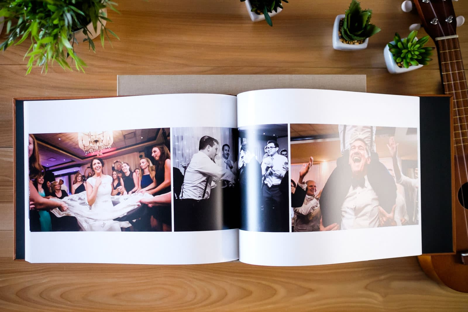 A look at a wedding book spread with images from the wedding reception