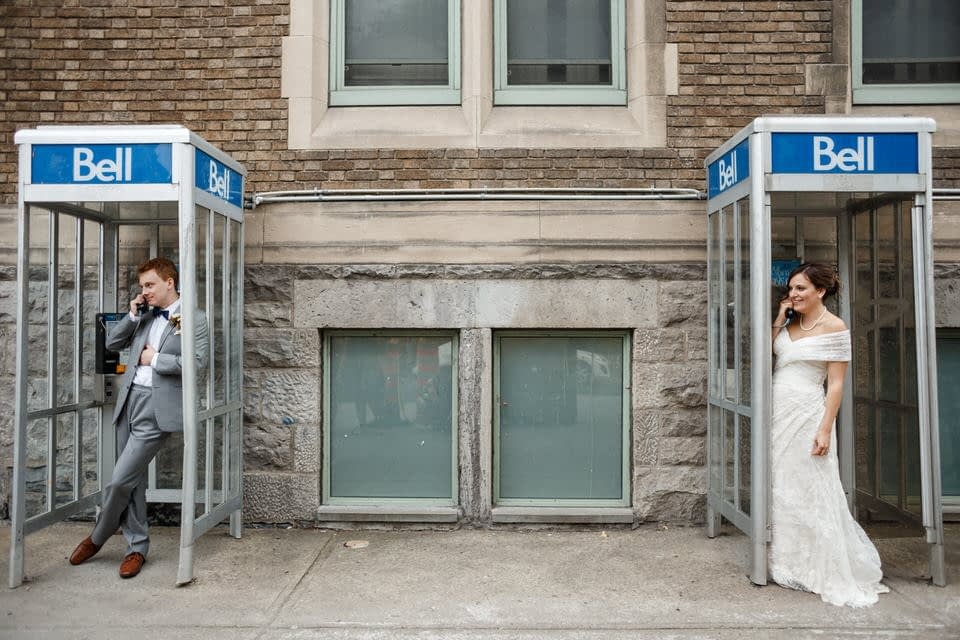Bride and Groom posing in a phone booth