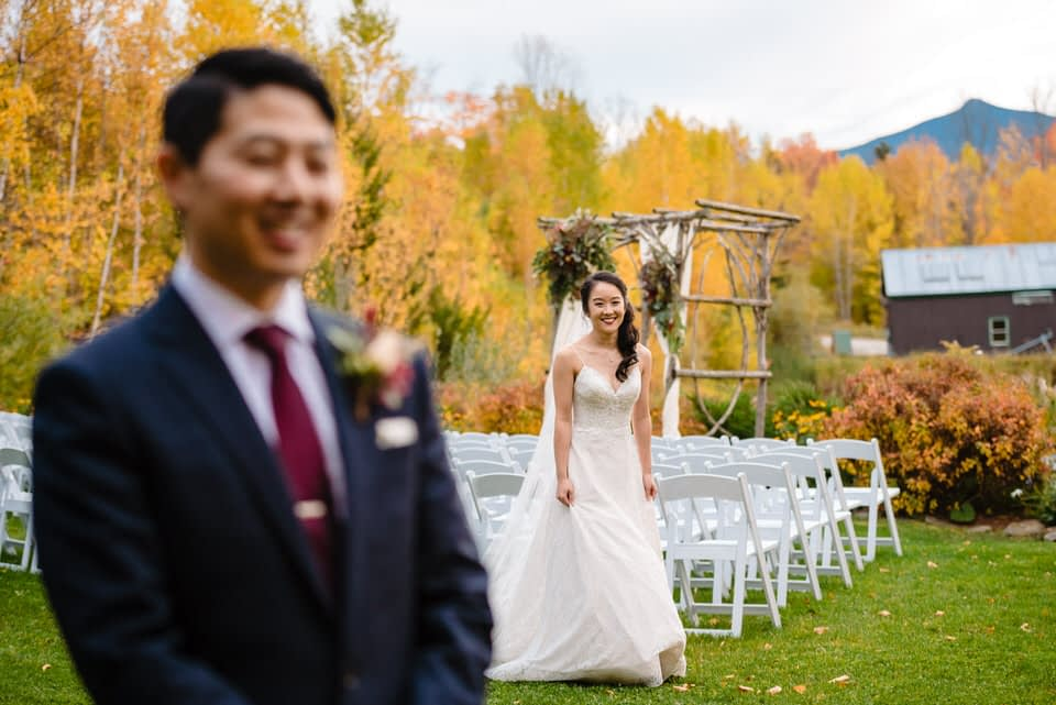 First look photo on wedding day in autumn