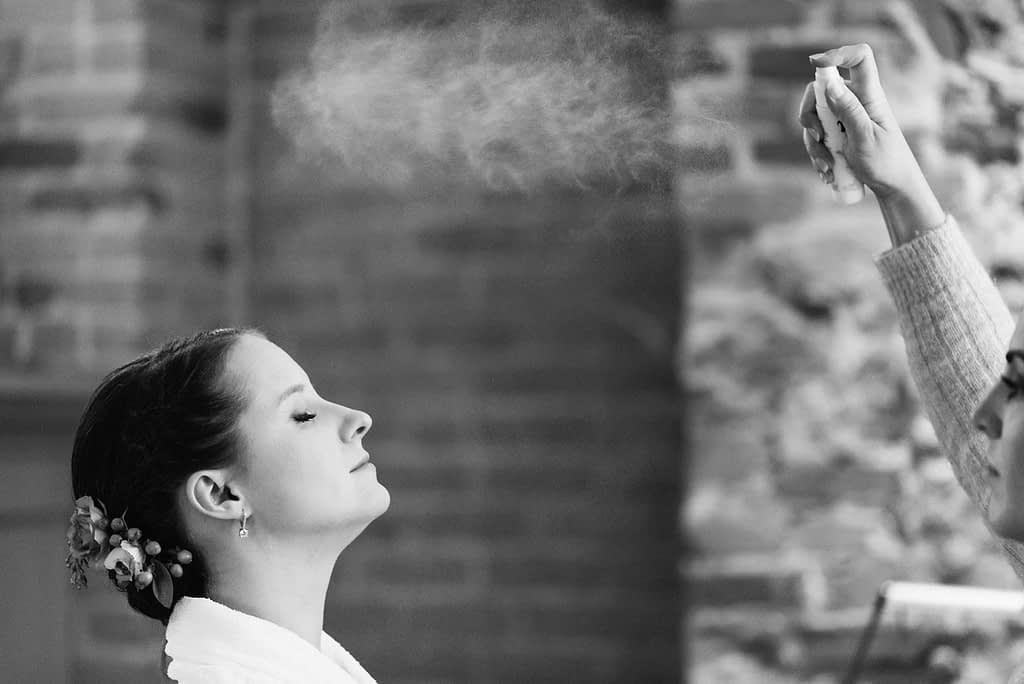 Bride being sprayed with fixing spray