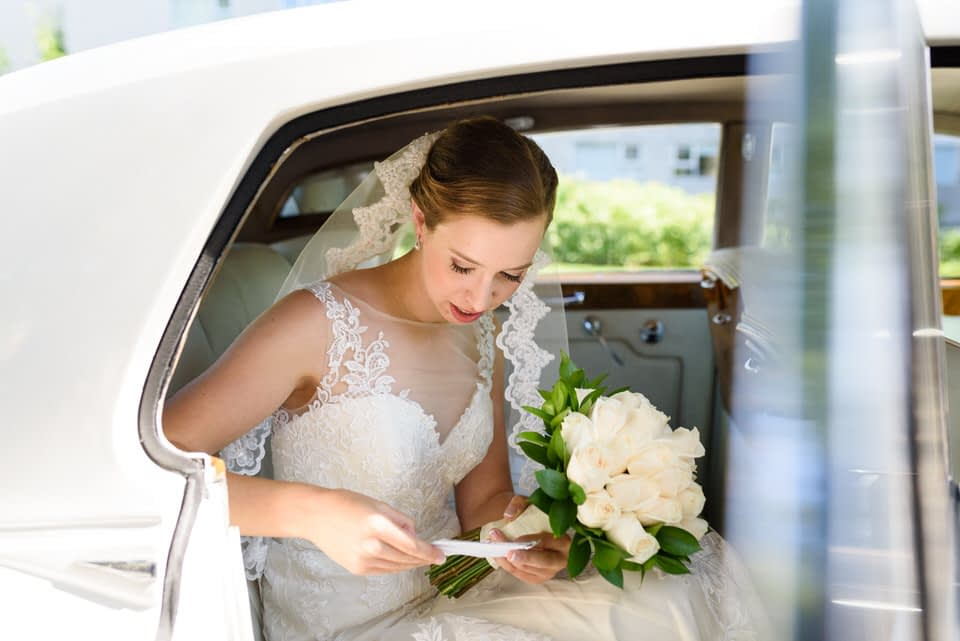 Bride reading her vows over in limo before ceremony