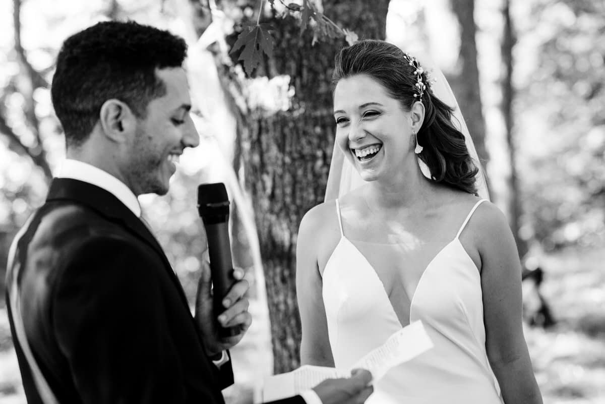 Bride smiling at the groom's wedding vows